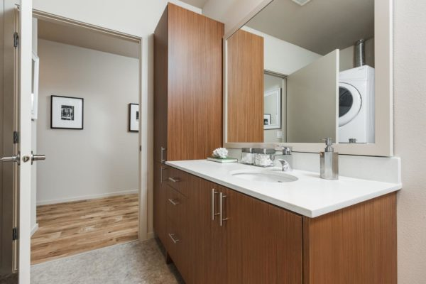 Bathroom at The Hayes on Stone Way with large cabinets and a single sink vanity