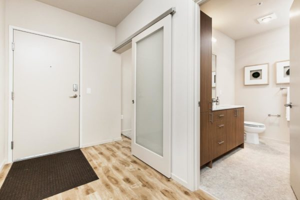 Entryway ofaHayes on Stone Way apartment that has hardwood floors