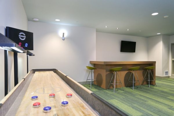 The Hayes on Stone Way game room with a shuffle board table