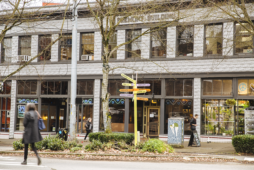 An exterior view of the Fremont building with people walking by